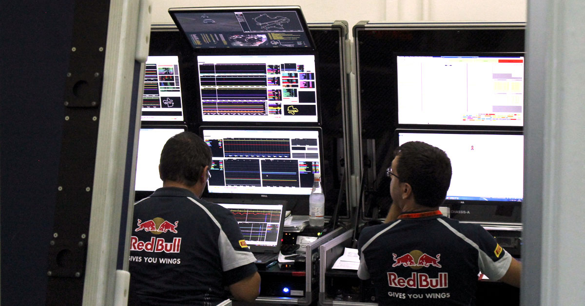 Race engineers with live telemetry data on their screens during a Formula 1 event in Malaysia